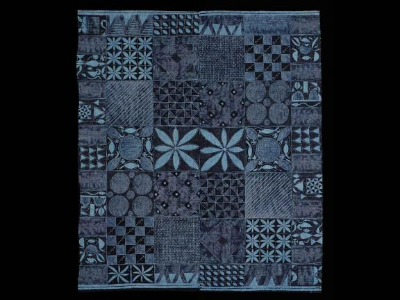 textile with blue and black geometric shapes