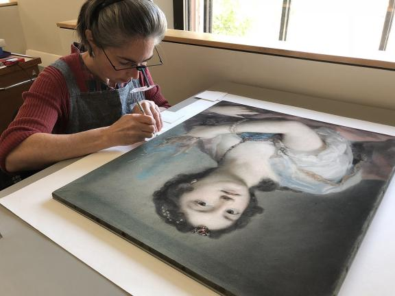 Conservator treating pastel on paper