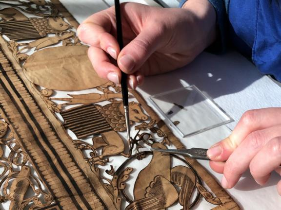 Treatment of cut-out paper artwork