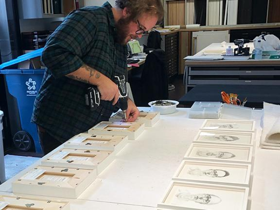 Framing of 21 drawings from the same series