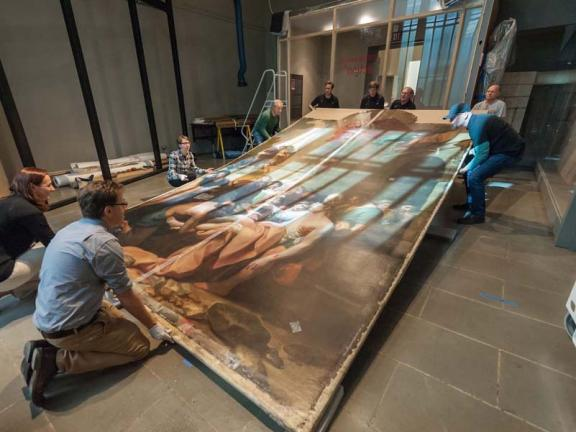 Oversize painting being lifted into upright position