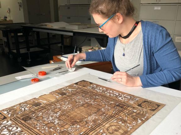 Conservator treating Judaica papercut