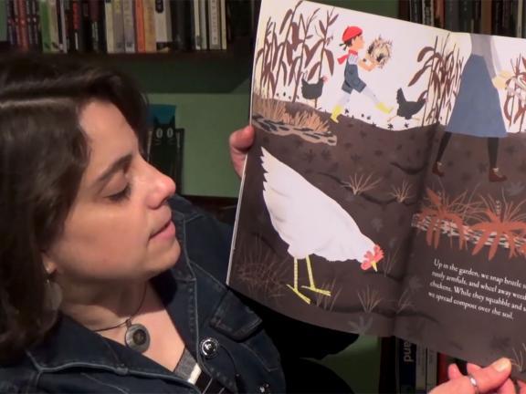 educator reading illustrated children's book