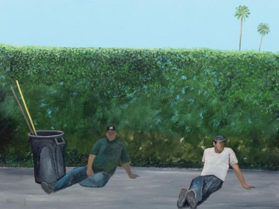 Two men wearing hats sit on pavement next to a trash can with gardening tools in front of a large green hedge bush