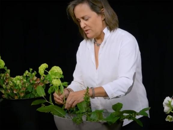 Floral arranger working with green flowers