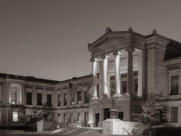 Black and white photograph of the Museum's Huntington facade in the evening