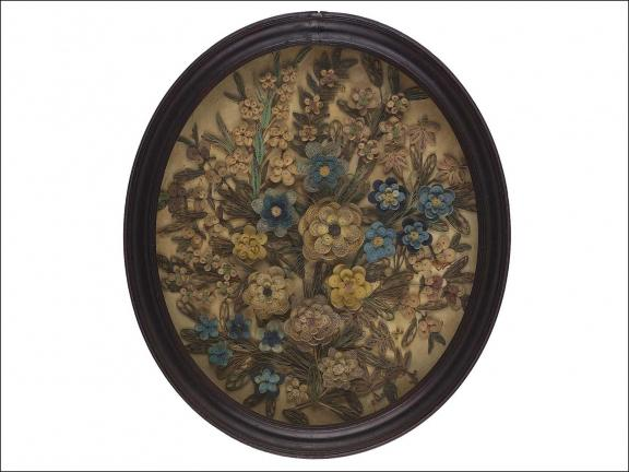 paper quilled flowers in a brown, oval frame