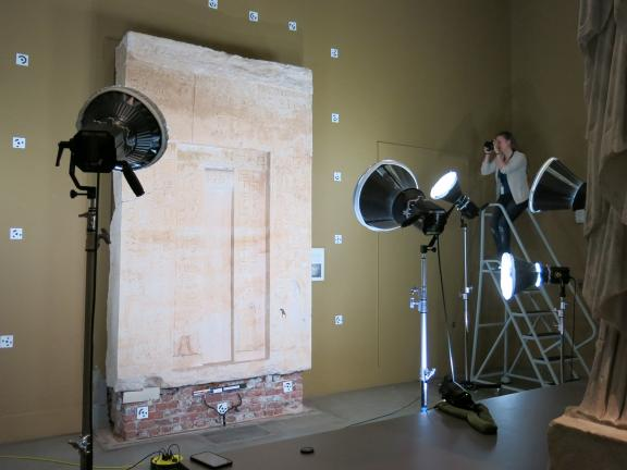 Conservator capturing images for photogrammetry of an ancient Egyptian false door