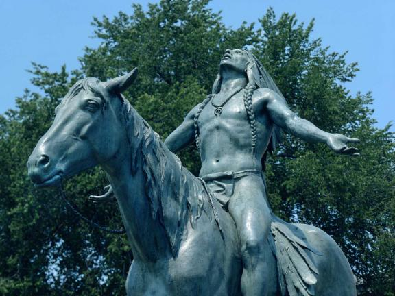 partial view of statue of a man on horseback.