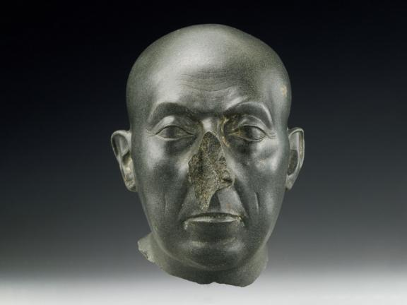 green colored sculpture of a man's head