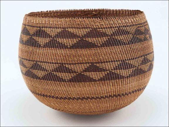 image of a brown and tan basket with triangle pattern