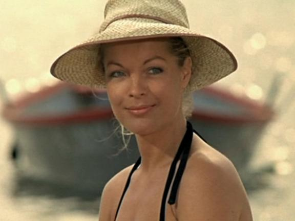 girl at the beach with a hat on