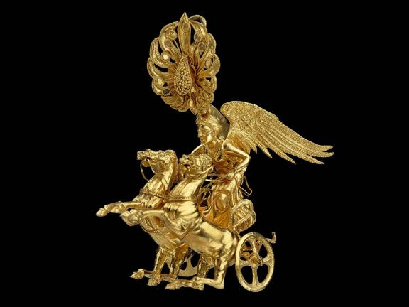 picture of a gold earring of Nike driving a two horse chariot