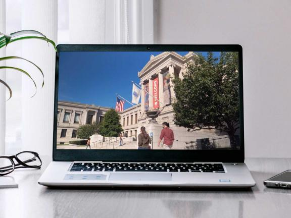 Laptop on a table with MFA facade on screen