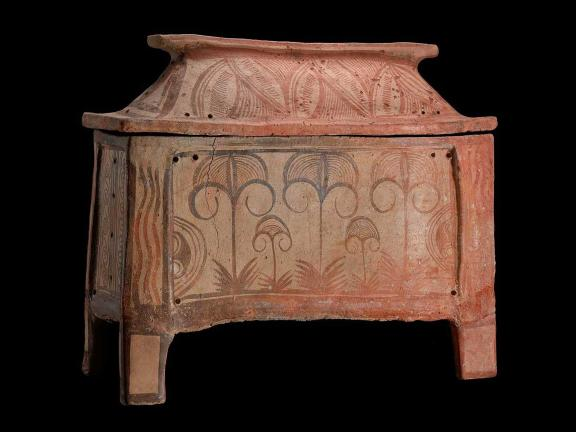 picture of a terracotta color coffin