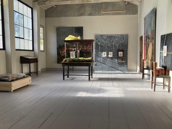 picture of a gallery with wooden sculptures in it