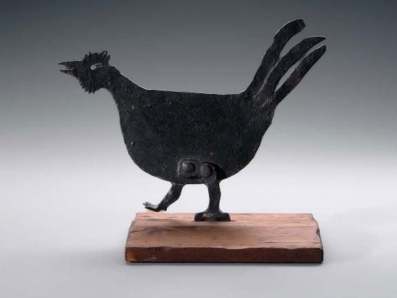 Black iron sculpture of rooster