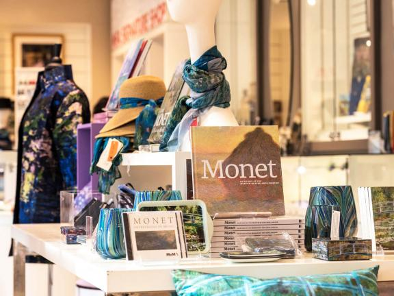 Display of Monet-related books and products on a table in the Museum shop