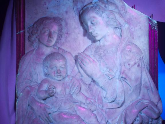 The marble relief Virgin Adoring the Child under ultraviolet light.