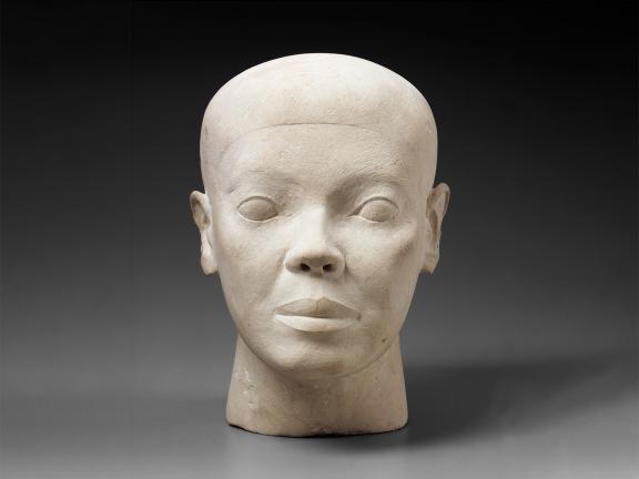 White limestone bust of man's head.