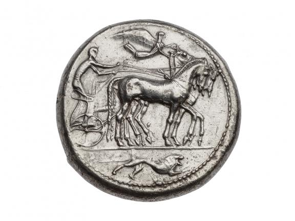 Silver coin with image of horse drawn chariot and driver