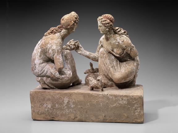 Terracotta sculpture of girls playing knucklebones game.