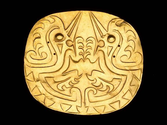 gold embossed disk pectoral depicting two bird-like zoomorphs