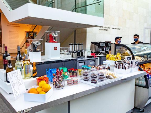 Counter with an arrangement of packaged foods at kiosk in Shapiro Family Courtyard