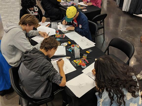 Teens creating footwear designs