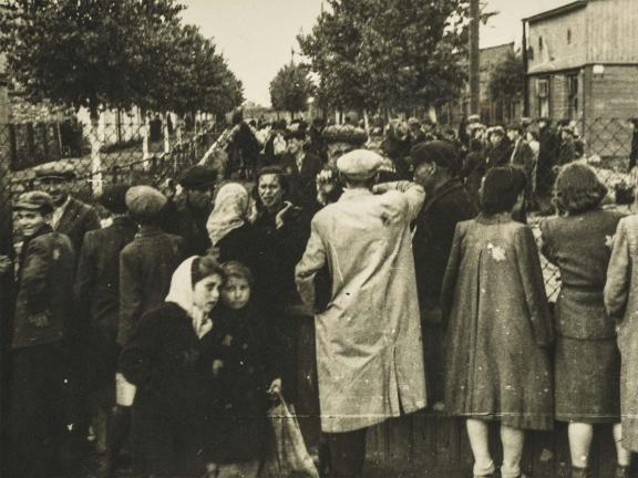 Black and white photograph of men, women and children at Litzmann (Lodz) Ghetto