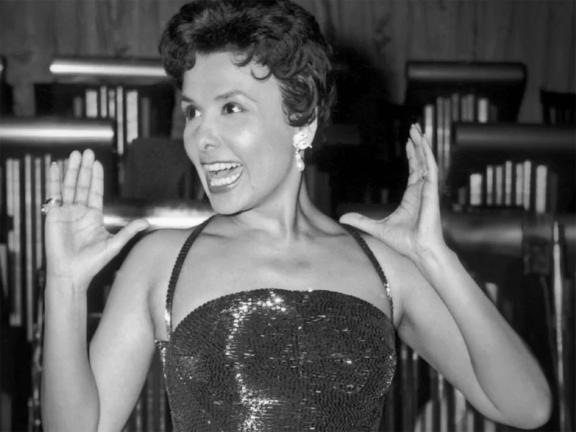 Black and white photograph of Lena Horne in a sequined gown