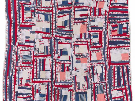 """Red, white, and blue quilt made from pieced strips of solid and printed (""""Vote"""") cotton."""