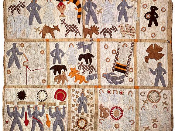 Colorful quilt made of multiple squares with figures and animals.