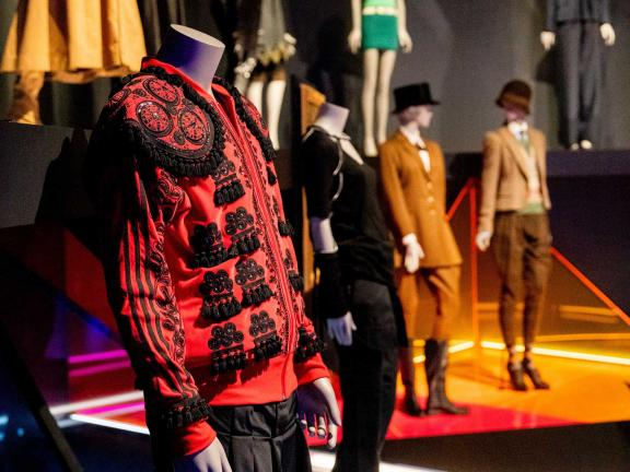 Red Jacket designed by Jeremy Scott for Adidas Originals in an installation view of Gender Bending Fashion
