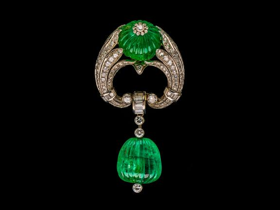 Art Deco platinum, carved emerald and diamond brooch, about 1937
