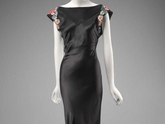 Silk satin and embroidered long evening dress designed by Travis Banton and worn by Anna May Wong