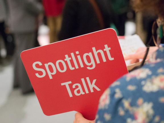 Close up of Spotlight Talk sign held by guide