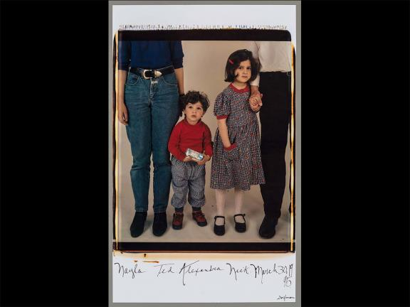 Large format polaroid of parents with children