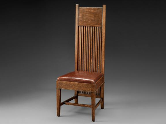 Tall back side chair designed by Frank Lloyd Wright