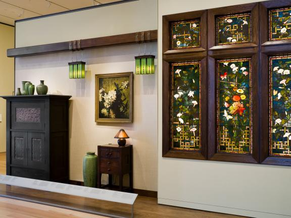 View of various decorative art pieces in American Arts and Crafts gallery