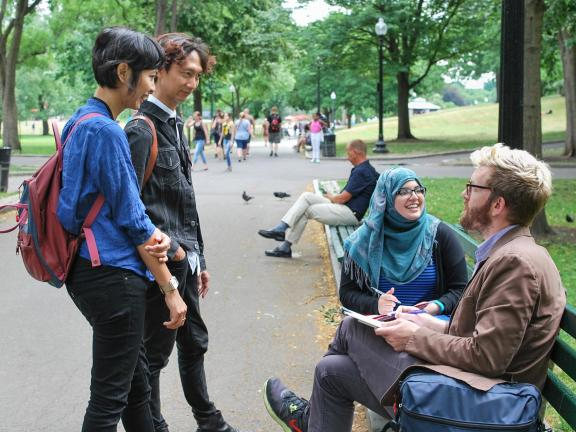 Artists Tita and Irwan engaging a pair of friends in Boston Common