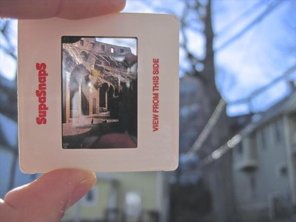 Photo of a hand holding a photo slide