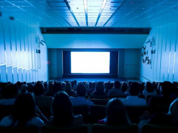 Visitors seated in Remis Auditorium during film screening