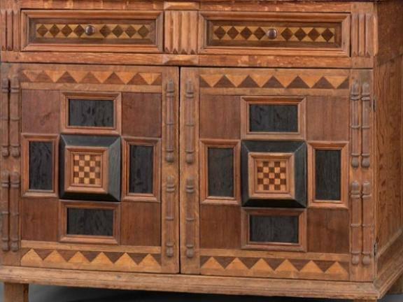 Detail of front of late 15th century American chest of drawers with doors