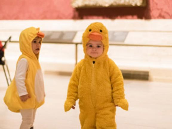 Two kids in duck costumes at the 2015 Museum Council Halloween event