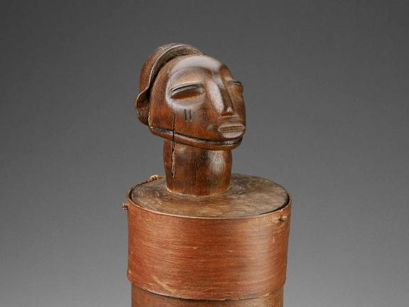 detail of jewelry box in form of human figure, with head above box compartments