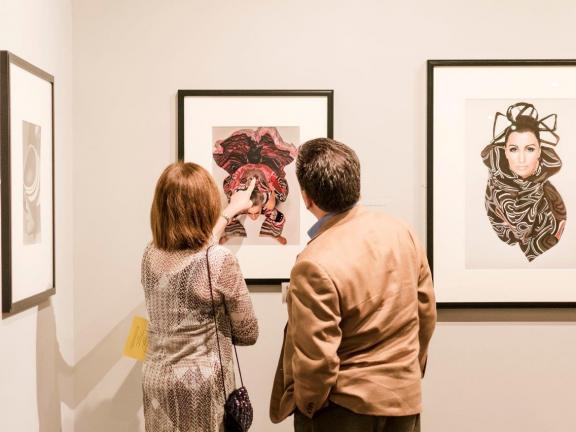 Patrons looking at art