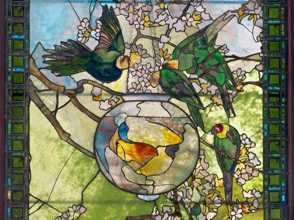 Stained glass window designed by Louis Comfort Tiffany depicting Parakeets and Gold Fish Bowl, about 1893