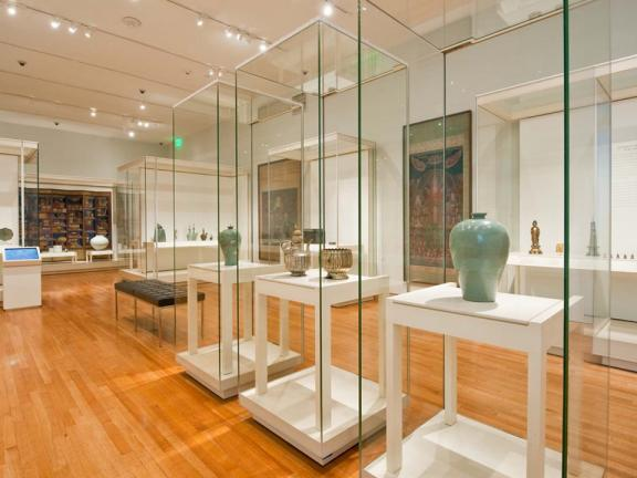 View of Arts of Korea gallery, with several display cases featuring Korean pottery