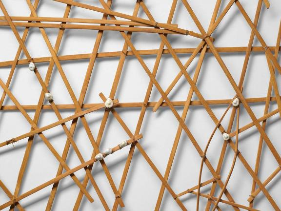 A Navigational Chart made in the 20th-mid 20th century using bamboo, cowrie shells, and twin tied together in a grid form